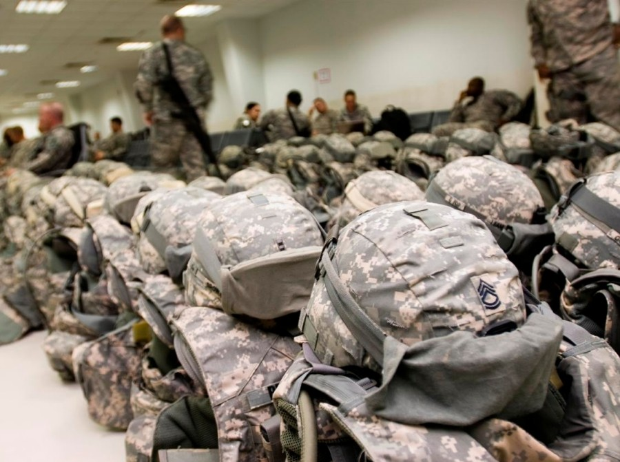 Helmets and body armor are lined up prior to departure at the passenger terminal at Joint Base Balad, Iraq