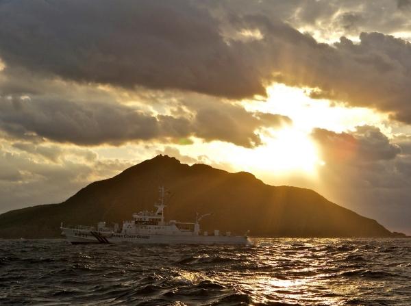 A Japanese Coast Guard patrol vessel passes by Uotsuri, the largest island in the Senkaku/Diaoyu chain