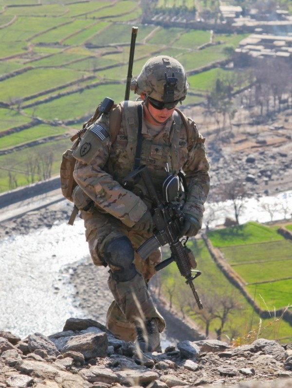 A U.S. soldier climbs a mountain in Watapur district, Kunar province, Afghanistan, January 11, 2012