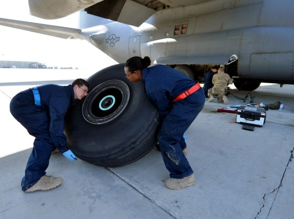 Crew chiefs replace a tire on a C-130 Hercules, March 6, 2013, on Bagram Airfield, Afghanistan