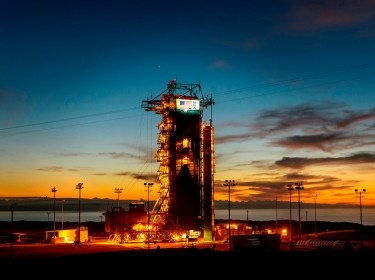 The sun sets behind Space Launch Complex 2 at Vandenberg Air Force Base, California