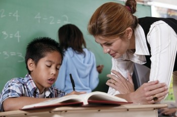 A teacher helping a student with math