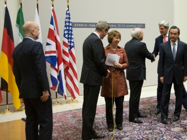 U.S. Secretary of State John Kerry shakes hands with Iranian Foreign Minister Javad Zarif after the P5+1 and Iran concluded negotiations about Iran's nuclear capabilities on November 24, 2013