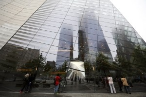 An image of one of the original World Trade Center Towers is displayed in the window of the 9/11 Memorial Museum pavilion during the dedication ceremony May 15, 2014