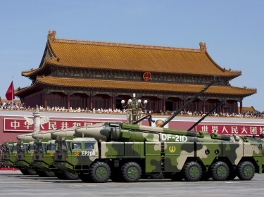 Chinese militaary vehicles carrying DF-21D anti-ship ballistic missiles, potentially capable of sinking a U.S. Nimitz-class aircraft carrier in a single strike, travel past Tiananmen Gate during a military parade to commemorate the 70th anniversary of the end of World War II in Beijing Thursday Sept. 3, 2015