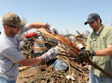 residents clean up after the tornado that hit Moore, Oklahoma on May 20, 2013
