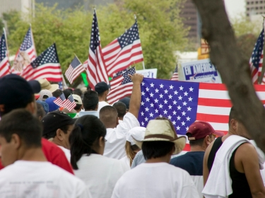 protesters marching with American flags