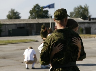 Woman hugging soldier