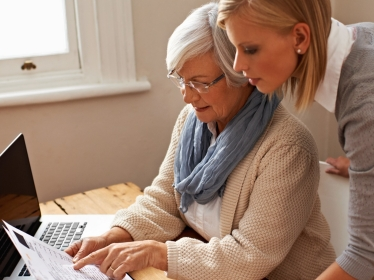 Older woman gets help with her tax documents