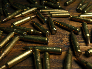 Many bullets on a table