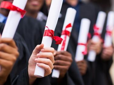 Students hold diplomas