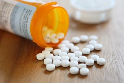 Pills from a prescription drug bottle