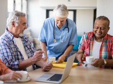 Nursing home residents having coffee