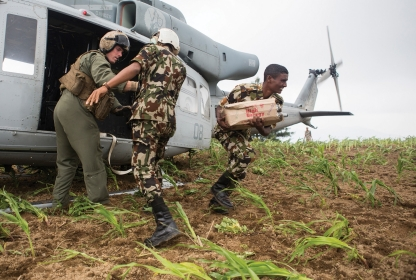 Nepalese soldiers unload aid and relief supplies from a UH-1Y Venom in the Kavrepalanchowk District, May 11, 2015