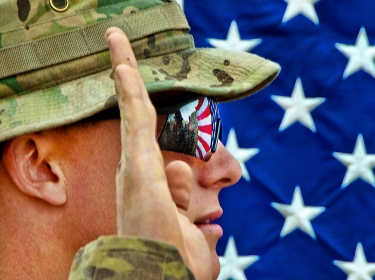 The American flag reflects in the glasses of an Army officer in Ghazni province, Afghanistan, April 22, 2012