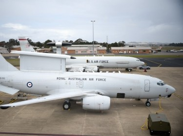 In the foreground, an early warning aircraft from the Royal Australian Air Force