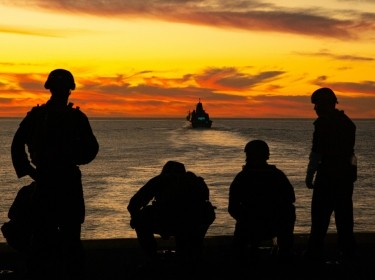 U.S. Marines and sailors post security from the Wasp-class amphibious assault ship USS Essex (LHD-2) off the coast of Southern Calif., December 4, 2020, photo by Lance Cpl. Cameron Rowe/U.S. Marine Corps