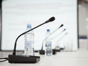 Microphones on a panel table at a conference