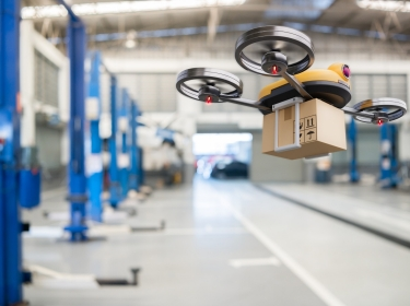 Spare part delivery drone at garage storage in leading automotive car service center for delivering mechanical shipping component part assembling to customeSpare part delivery drone at garage storage in leading automotive car service center for delivering mechanical shipping component part assembling to customer, photo by Shutter2U/Getty Images