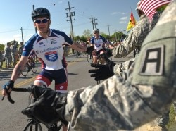 Soldiers, civilians, and family members from Division West, First Army, cheer Healing Heroes and other cyclists during the annual Texas Challenge event of the Ride to Recovery at Fort Hood, TX Apr 11.