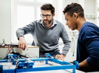 University tutor assisting student with technical problem