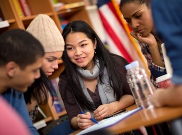 Teamwork of students working on task together, photo by luckybusiness/AdobeStock