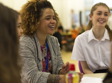 Teacher and students in the classroom, photo by dglimages/AdobeStock