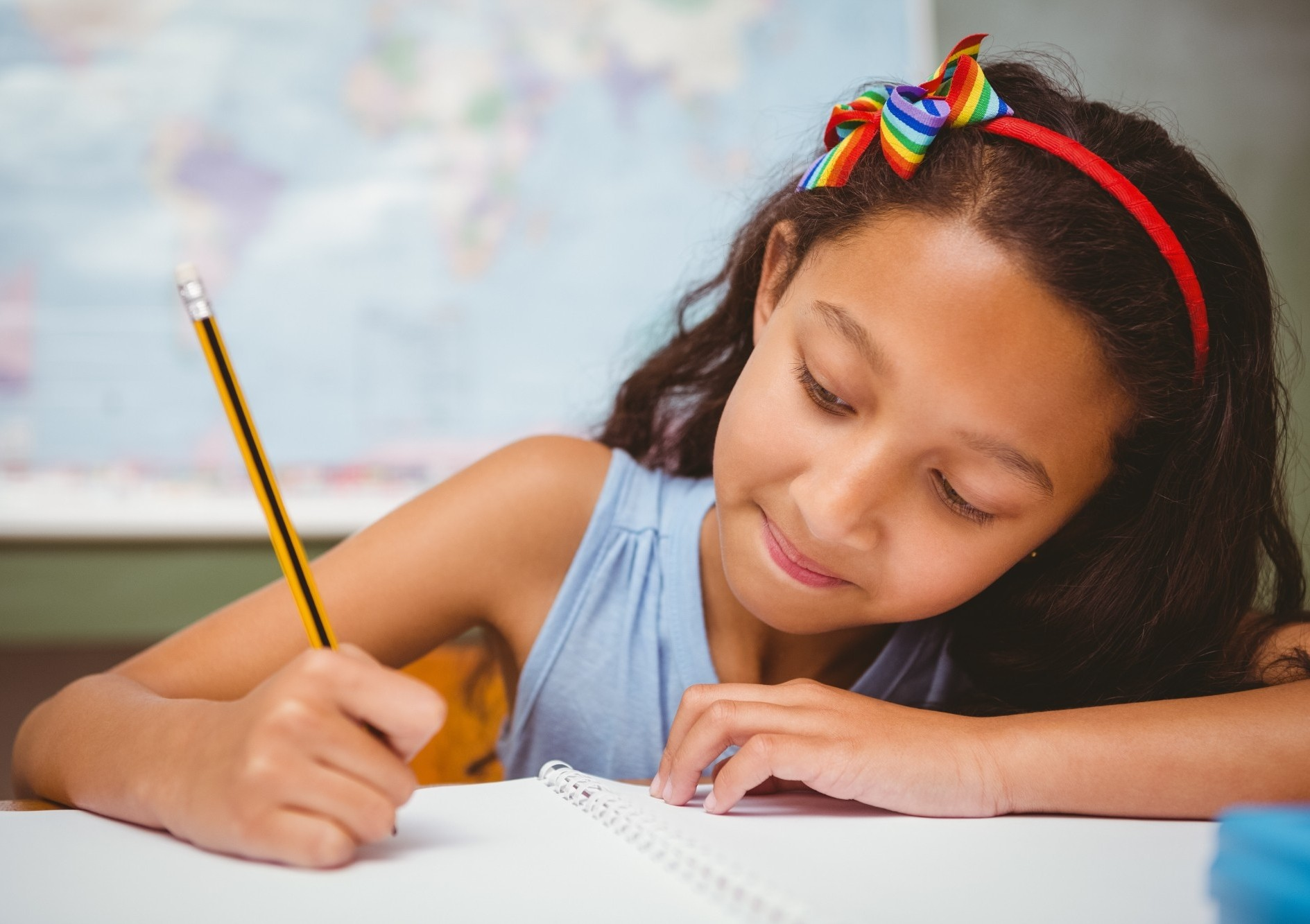 Young female student writes in her notebook