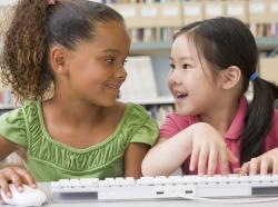 kindergarten girls using computer