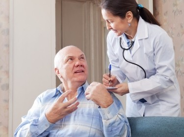 behavioral health patient talking to his doctor