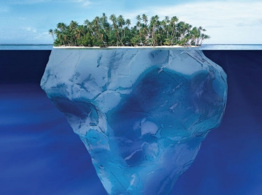 A view of an island above and below water