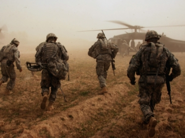 U.S. Army Soldiers run to UH-60 Black Hawk helicopters after conducting a search for weapons caches in Albu Issa, Iraq, March 2008