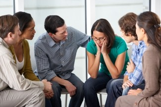 Woman upset during group therapy session