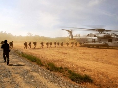 U.S. Marines board a CH-53E Super Stallion helicopter during airlift operations as part of an exercise on Camp Imazu in Takashima, Japan, Sept. 15, 2015