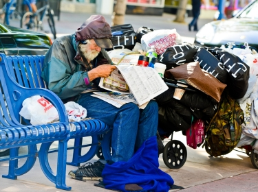 Homeless man sitting on a bench in Los Angeles