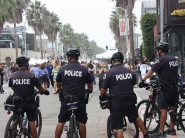 LAPD officers on bikes on the Venice boardwalk