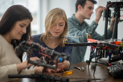 Students working in a lab on a drone project
