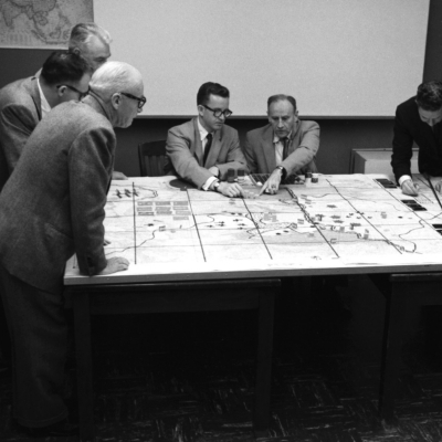 Researchers demonstrating a gaming exercise for board members in Santa Monica, 1966