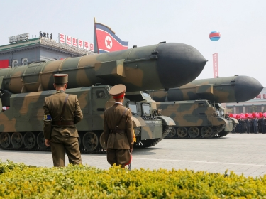Missiles are driven past the stand with North Korean leader Kim Jong Un during a military parade marking the 105th birth anniversary of North Korea's founding father, Kim Il Sung, in Pyongyang, April 15, 2017