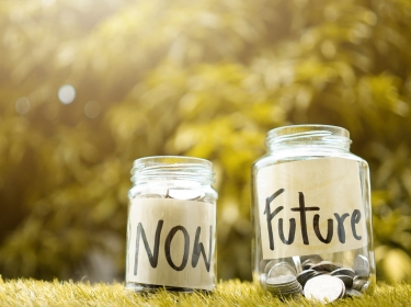 Coin jars labelled 'now' and 'future'