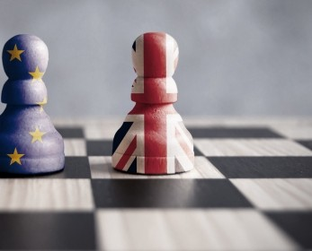 Chess pieces painted in the European Union and Union Jack flags, representing Brexit negotiations.
