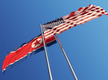 American and North Korean flags facing opposite directions