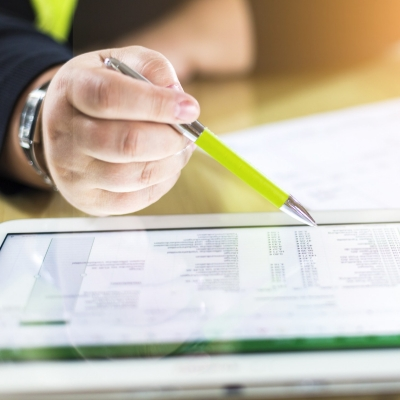 Accounting on a tablet computer, close-up, photo by mmphoto/Adobe Stock