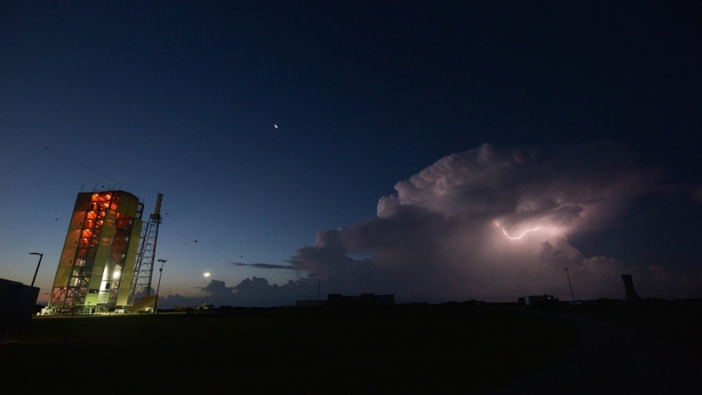 Lightning strikes at dawn near NASA's Orion test vehicle