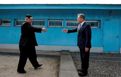 South Korean President Moon Jae-in and North Korean leader Kim Jong Un shake hands at the truce village of Panmunjom inside the demilitarized zone separating the two Koreas, April 27, 2018, photo by Korea Summit Press Pool/Pool via Reuters
