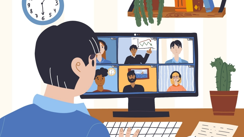 A man participates in a virtual meeting from home