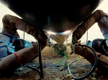 Welders at work on a natural gas pipeline
