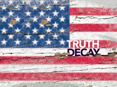 The words Truth Decay over a fading American flag painted on wood