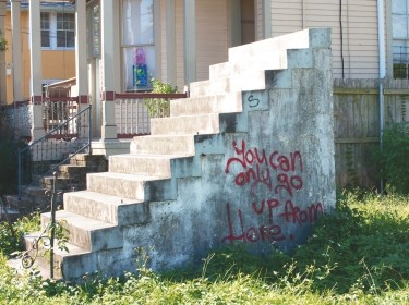 Cement stairs outside of a home in New Orleans