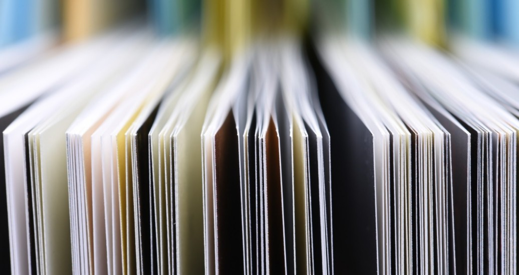 Closeup of the edges of open books, photo by FactoryTh/Getty Images